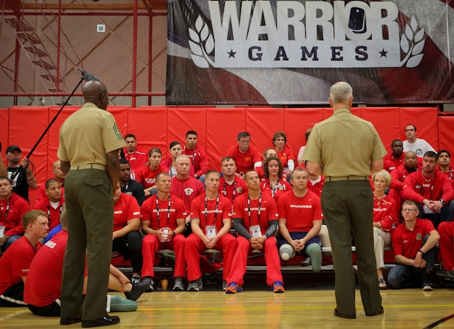 Commandant of the Marine Corps Gen. James Amos and Sgt. Maj. of the Marine Corps Carlton Kent met with players and family members of the All-Marine volleyball team to say they are very proud of the Marines' success at the 2011 Warrior Games during a visit May 19, 2011, at the Olympic Training Center in Colorado Springs, Colo. The 48-member team, consisting of active-duty and veteran wounded, ill or injured Marines, are going head-to-head against the other branches of the Armed Forces to defend its 2010 title.