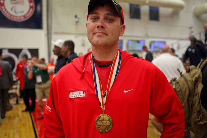 Marine veteran Sgt. Daniel Govier was awarded recurve archery gold medal at the 2011 Warrior Games May 19, 2011, at the Olympic Training Center in Colorado Springs, Colo. Commandant of the Marine Corps Gen. James Amos presented the gold medal to Govier, a native of Boscobel, Wis., and the bronze medal to Sgt. Stephen Lunt, a native of Charleston, S.C., in the Warrior Games recurve archery event.