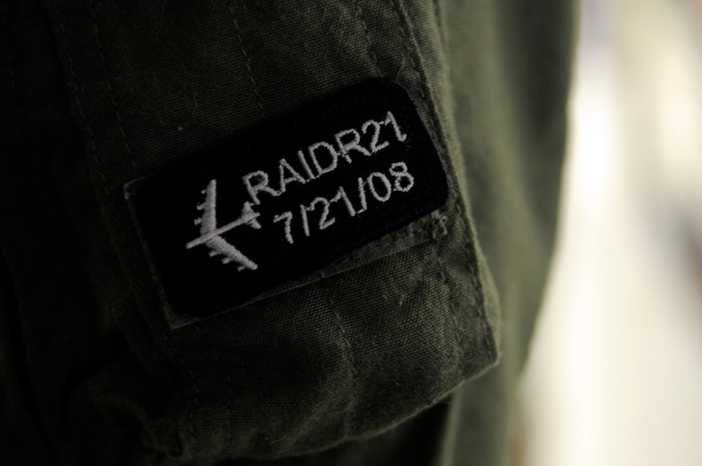 Aircrew from the bomber community sometimes wear a RAIDR 21 Tab patch to honor and remember their fallen brothers. RAIDR 21 was the call sign of a B-52H from Barksdale Air Force Base, La., which crashed off the coast of Guam July 21, 2008, killing the six aircrew. (U.S. Air Force photo/Staff Sgt. John Gordinier)(RELEASED)