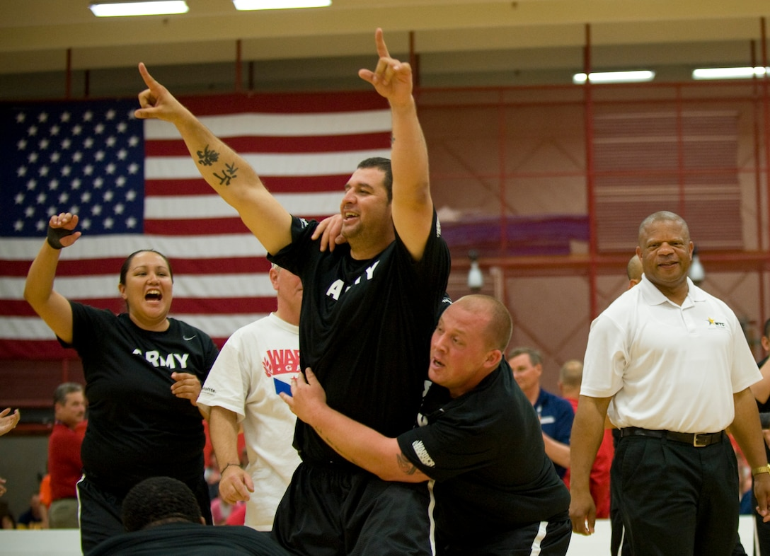 Members of the Army sitting volleyball team celebrate after winning a close game against the Air Force May 19, 2011, during the the second annual Warrior Games in Colorado Springs, Colo. The Army won the series with two straight games. (U.S. Air Force photo/Staff Sgt. Christopher Griffin)