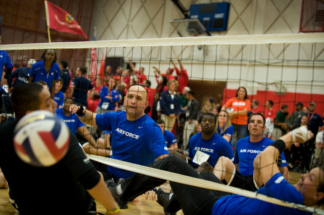 Members of the Air Force sitting volleyball team watch as they score a point against the Army May 19, 2011, during the the second annual Warrior Games in Colorado Springs, Colo. The Army won the series with two straight games. (U.S. Air Force photo/Staff Sgt. Christopher Griffin)