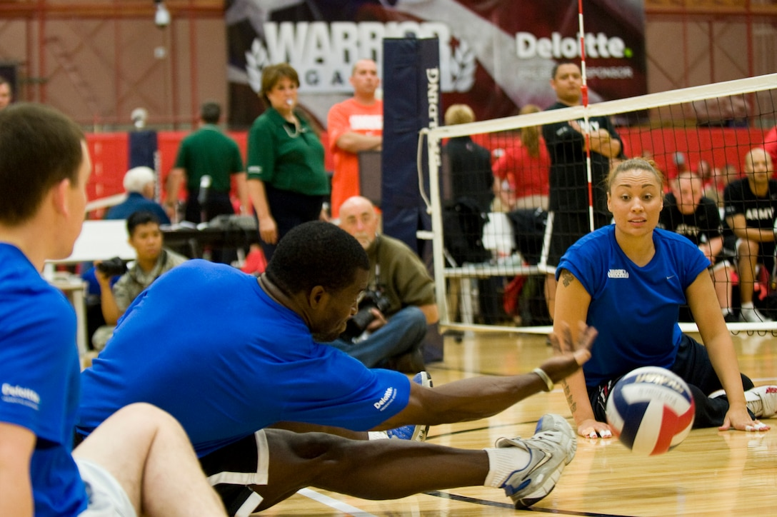 Members of the Air Force sitting volleyball team reach for the volleyball as it's spiked onto their side by the Army May 19, 2011, during the the second annual Warrior Games in Colorado Springs, Colo. The Army won the series with two straight games. (U.S. Air Force photo/Staff Sgt. Christopher Griffin)