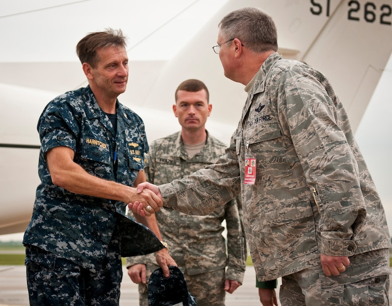 Lt. Col. David Mounkes (right), commander of the Kentucky Air National Guard's 123rd Contingency Response Element, greets Vice Adm. Mark D. Harnitchek, deputy commander of United States Transportation Command, as he arrives at Springfield-Branson National Airport in Springfield, Mo., on May 19, 2011. Admiral Harnitchek was on hand for a news conference on National Level Exercise 2011, a weeklong training scenario involving a massive earthquake along the New Madrid fault line requiring extensive aeromedical evacuation of injured patients. The Kentucky Air National Guard's 123rd Contingency Response Element was responsible for establishing an initial-response air hub in Springfield during the exercise. (U.S. Air Force photo by Senior Airman Maxwell Rechel)