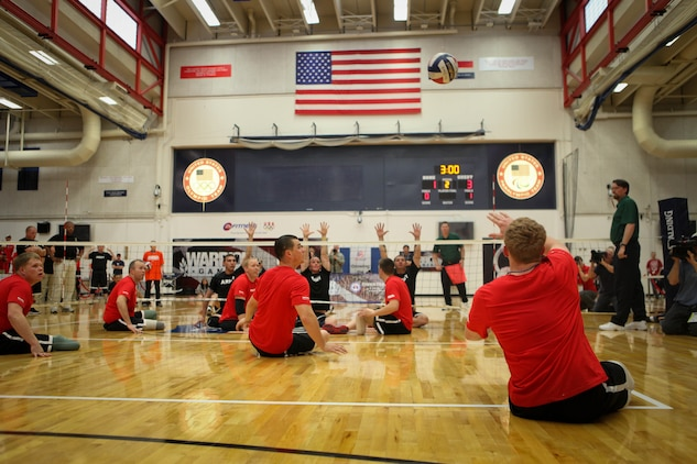 Lance Cpl. Joshua Wege, a Campbellsport, Wis., native on the All-Marine sitting volleyball team, serves to the All-Army team during the gold medal game May 20, 2011, at the Olympic Training Center in Colorado Spring, Colo. It took the Marines just the first two matches of a best-of-three game series to beat the Army and defend their title in the Warrior Games event. The All-Marine sitting volleyball team, consisting of active-duty and veteran wounded warriors, went head-to-head against all other branches of the Armed Forces, including a Special Operations Command team. The Marines were undefeated.