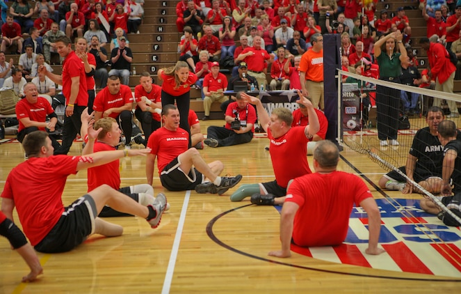 Lance Cpl. Jese Schag, a Sheridan, Ill., native on the All-Marine sitting volleyball team, leads the Marines in a celebration after a point during the gold medal game against the Army May 20, 2011, at the Olympic Training Center in Colorado Spring, Colo. It took the Marines just the first two matches of a best-of-three game series to beat the Army and defend their title in the Warrior Games event. The All-Marine sitting volleyball team, consisting of active-duty and veteran wounded warriors, went head-to-head against all other branches of the Armed Forces, including a Special Operations Command team. The Marines were undefeated.