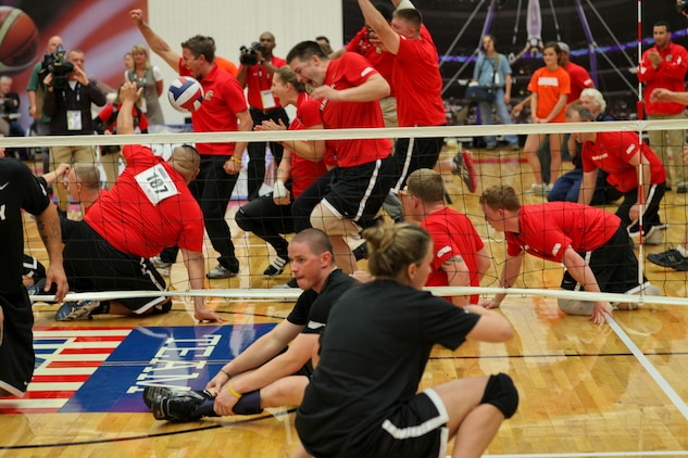 The Marines celebrate a victory against the Army in sitting volleyball during the gold medal game May 20, 2011, at the Olympic Training Center in Colorado Spring, Colo. It took the Marines just the first two matches of a best-of-three game series to beat the Army and defend their title in the Warrior Games event. The All-Marine sitting volleyball team, consisting of active-duty and veteran wounded warriors, went head-to-head against all other branches of the Armed Forces, including a Special Operations Command team. The Marines were undefeated.