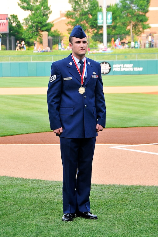 Indiana Air National Guard Staff Sgt. Andrew Carboneau stands on Victory Field, home of the Indianapolis Indians, in Indianapolis, Ind. on May 20, 2011.  Carboneau was just awarded Airman of the Year for 2010 for the Indiana Air National Guard and was being presented the award at the Armed Forces Day Picnic.  Photo by Indiana Air National Guard Staff Sgt. Justin Goeden. RELEASED