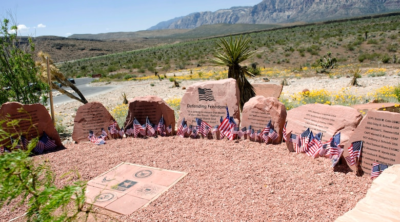 LAS VEGAS -- The Defending Freedom Memorial is located at the Red Rock National Conservation Area in Las Vegas.  The memorial was initially dedicated in 2005 and is comprised of seven sandstones with the engraved names of Nevada's fallen servicemen and women. In 2011, the names Nellis Airmen Senior Airman Michael Buras, Staff Sgt. David Smith, 1st Lt. Joel Gentz and Capt. David Wisniewski were added to the memorial. All four Airmen were lost in 2010 while supporting operations in Afghanistan.  (U.S. Air Force photo by Airman 1st Class Jamie L. Nicley)