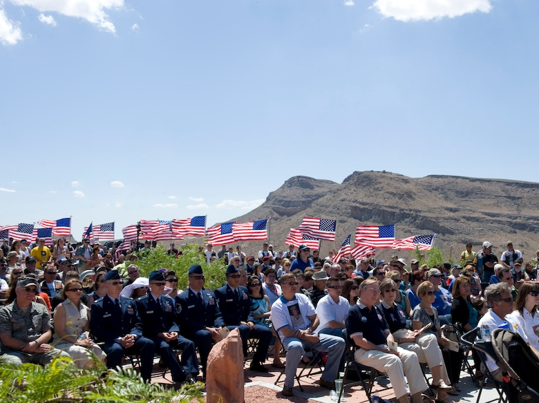 LAS VEGAS -- Attendees listen as guest speakers honor fallen servicemembers with Nevada ties during the 6th annual Defending Freedom Memorial dedication ceremony at the Red Rock National Conservation Area May 14, 2011. The Defending Freedom Memorial was initially dedicated in 2005 and is comprised of seven sandstones with the engraved names of Nevada's fallen servicemen and women. This year, the names Nellis Airmen Senior Airman Michael Buras, Staff Sgt. David Smith, 1st Lt. Joel Gentz and Capt. David Wisniewski were added to the memorial. All four Airmen were lost in 2010 while supporting operations in Afghanistan.  (U.S. Air Force photo by Airman 1st Class Jamie L. Nicley)