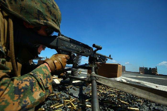 Lance Cpl. Raymond Cruz, machine-gunner, Weapons Platoon, Landing Force Company, fires an M-240B machine gun during a machine gun drill May 23 aboard the amphibious transport dock ship USS Tortuga (LSD 46). The Marines conducted the shoot to keep up their qualifications as well as to prepare them for upcoming training during Cooperation Afloat Readiness and Training (CARAT) 2011. CARAT is a series of bilateral exercises held between U.S. and Southeast Asian defense forces with the goals of enhancing regional cooperation, promoting mutual trust and understanding, and increasing operational readiness. The majority of the Marines comprising the landing force are volunteers from 2nd Battalion, 23rd Marine Regiment, 4th Marine Division and 4th Assault Amphibian Battalion, 4th Marine Division. Reserve Marines are an integral element of the Marine Corps total force and regularly participate in operations and theater security cooperation exercises overseas. (U.S. Marine Corps Photo by Cpl. Aaron Hostutler)