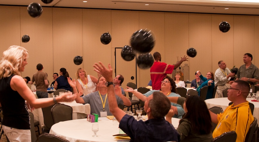 Attendees at the western regional Yellow Ribbon Event work together to keep a room full of balloons in the air during a game at the end of the event. The event, May 14-15 at the Tempe Mission Palms Resort in Tempe, Ariz., was designed to help prepare Reservists, Guardsmen and their families for upcoming deployments, as well as to welcome those who had recently returned home. (U.S. Air Force Photo/Staff Sgt. Erin Smith)