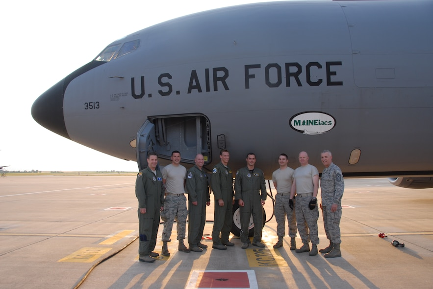 Members of the 313th Air Expeditionary Wing gather for a photo following the 1,000th sortie flown in support of Operation Unified Protector, a NATO-led mission enhancing a no fly zone established by United Nations Security Council Resolution 1973 over Libya.  (U.S. Air Force photo by Capt. Dicie