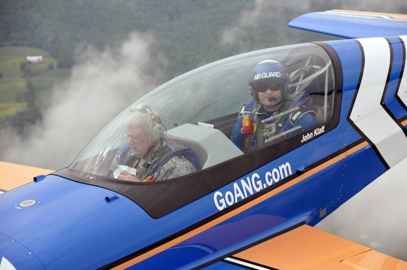 Air Force Lt. Col. John Klatt, the pilot of the Air National Guard's stunt plane, practices techniques with Air Force Tech. Sgt. John Orrell, a journalist assigned to the National Guard Bureau, riding along in the front seat to gain a firsthand experience of what a stunt flyer does, May 19, 2011. Klatt flies a Panzl S330 at most of the major air shows across the United States, sharing the story and spreading the awareness of the Air National Guard. (Courtesy photo) (Released)