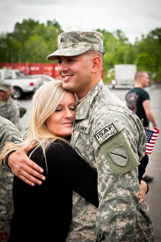 Sgt. Shahid M. Iqbal hugs his fiance, Kara Feese, during a welcome home ceremony held May 1, 2011, at the Kentucky Air National Guard Base in Louisville, Ky., for members of the Kentucky National Guard's Agribusiness Development Team II. Comprised of about 60 Army and Air National Guardsmen, KYADT II just returned from a 12-month deployment to Afghanistan, where they worked to make Afghani farmers become agriculturally self-sufficient, fostered business opportunities through a women's-empowerment initiative and provided force protection. Iqbal and Feese are getting married in July. (U.S. Air Force Photo by Maj. Dale Greer)
