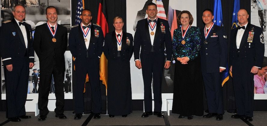 The annual awards winner pose for a photo with Gen. Mark A. Welsh III, U.S. Air Forces in Europe commander (far left), and Chief Master Sgt. Dave Williamson, USAFE command chief master sergeant (far right). The winners pictured are: Eren Ersoy, 39th Air Base Wing, Incirlik Air Base, Turkey; Capt. Gilbert Wyche, Master Sgt. Kathleen Ross and Tech. Sgt. Dustin Goodwin, 48th Fighter Wing, RAF Lakenheath, United Kingdom; and Theresa Vannier, 3rd Air Force and Senior Airman Johnny Nguyen, 86th Airlift Wing, Ramstein Air Base, Germany.  (U.S. Air Force photo by Senior Airman Caleb Pierce/Released)