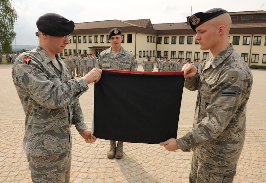 SPANGDAHLEM AIR BASE, Germany – German security police officers from the 52nd Security Forces Squadron fold the German flag during a retreat ceremony here May 20. The retreat ceremony coincided with National Police Week, which honors law enforcement members who have lost their lives in the line of duty for the safety and protection of others. (U.S. Air Force photo/Senior Airman Nathanael Callon)