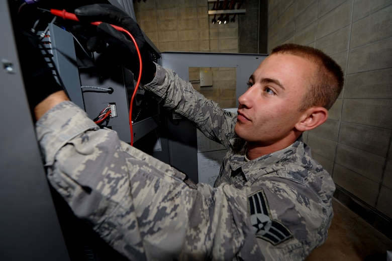 Senior Airman Derek Hunter, 18th Civil Engineer Squadron Heating, Ventilation, Air Conditioning and Refrigeration technician, checks electrical circuits on a heating ventilation and cooling system April 21. Kadena recently instituted an initiative through the Air Force Smart Operations for the 21st Century program to replace the antiquated, outdoor AC chillers with protected, indoor equipment to save the Air Force potentially millions of dollars in parts and energy. (U.S. Air Force photo/Staff Sgt. Jonathan Steffen)