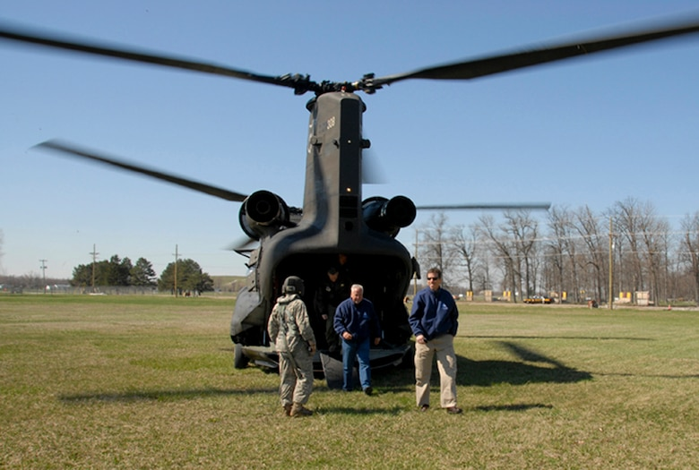 Members of the Young Presidents' Organization disembark from a Chinook helicopterat Camp Perry, in Port Clinton, Ohio, May 13, 2011. The YPO spent the day learning about the missions and leadership that make up the Ohio National Guard.