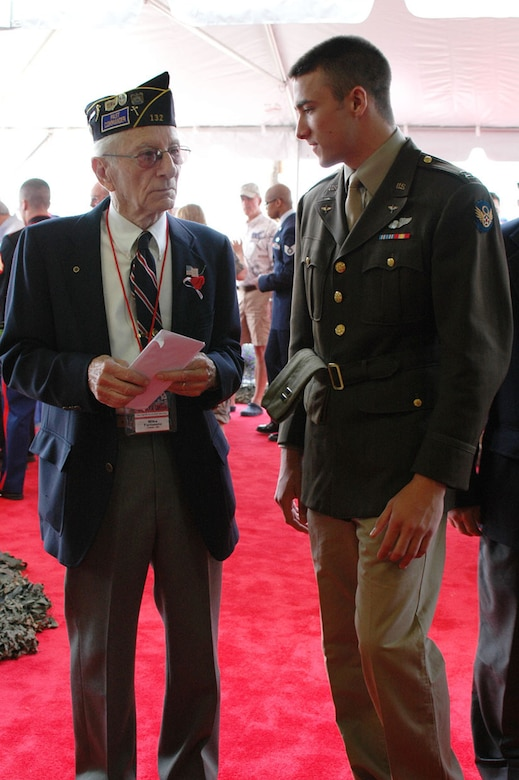 The son of Col. Steven Nordhaus, 180th Fighter Wing Commander, speaks with a World War II veteran at the Stage Door Canteen, hosted by the 180th Fighter Wing and Honor Flight of Northwest Ohio, May 21 at the 180th Fighter Wing.