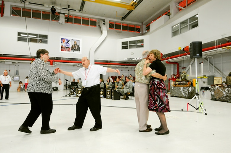 World War II veterans and their wives dance to the songs of the 338th Army band at the Stage Door Canteen, hosted by the 180th Fighter Wing and Honor Flight of Northwest Ohio, May 21 at the 180th Fighter Wing.