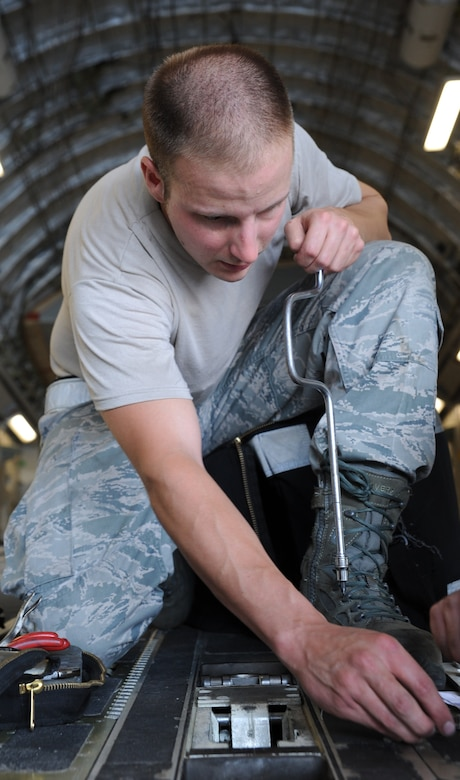 Senior Airman Aaron Jagow cleans and inspects the tow release mechanism on the ramp of a C-17 during a Home Station Check inspection on Joint Base Charleston - Air Base, May 23. HSC is a three-day inspection performed every 120 days. Airman Jagow is a member of the HSC department of the 437th Maintenance Squadron. (U.S. Air Force photo/ Staff Sgt. Nicole Mickle)