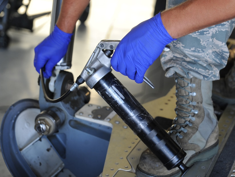 Staff Sgt. Adam Hall applies grease to a fitting on the cargo ramp actuator during a Home Station Check inspection of a C-17 on Joint Base Charleston - Air Base, May 23. HSC is a three-day inspection performed every 120 days. Sergeant Hall works for the HSC department of the 437th Maintenance Squadron.  (U.S. Air Force photo/ Staff Sgt. Nicole Mickle)