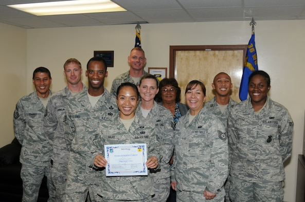 """Staff Sgt. Daisy Salas (center), 36th Contingency Response Group, was awarded Andersen's Best here May 25. Sergeant Salas leads a 13-person team, deployable to 42 countries in the Pacific Command's area of responsibility. She provided security for the Pacific Air Forces commander, General Gary North's visit to Bangladesh, and led the squadron's Compliance Inspection preparation, leading to the wing's only """"Outstanding"""" rating. Additionally, Sergeant Salas performs duties as a jumpmaster for 36 CRG Airborne Operations, one of three 36 CRG jumpmasters. (U.S. Air Force photo/Senior Airman Carlin Leslie)"""