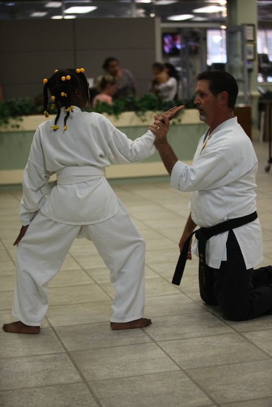 Sensei Keith James, instructor of the Okinawan Seidokan Karate Kobudo class reviews a sequence of movements with a student May 26 at the Midway Park Community Center. The class is available to student ages 5 and up on Tuesdays and Thursdays from 6:30 to 9 p.m. at the Midway Park Community Center.