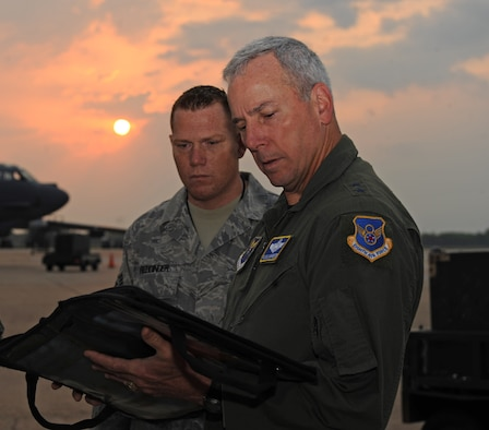 Maj. Gen. Floyd Carpenter, 8th Air Force commander, reviews the pre-flight check list with Staff Sgt.  Regis Reddinger, 2nd Maintenance Squadron, before his final B-52H Stratofortress flight on Barksdale Air Force Base, La., May 24. General Carpenter is retiring after 33 years of service and 3,000 flight hours in the B-52. (U.S. Air Force photo/Airman 1st Class Micaiah Anthony) (RELEASED)