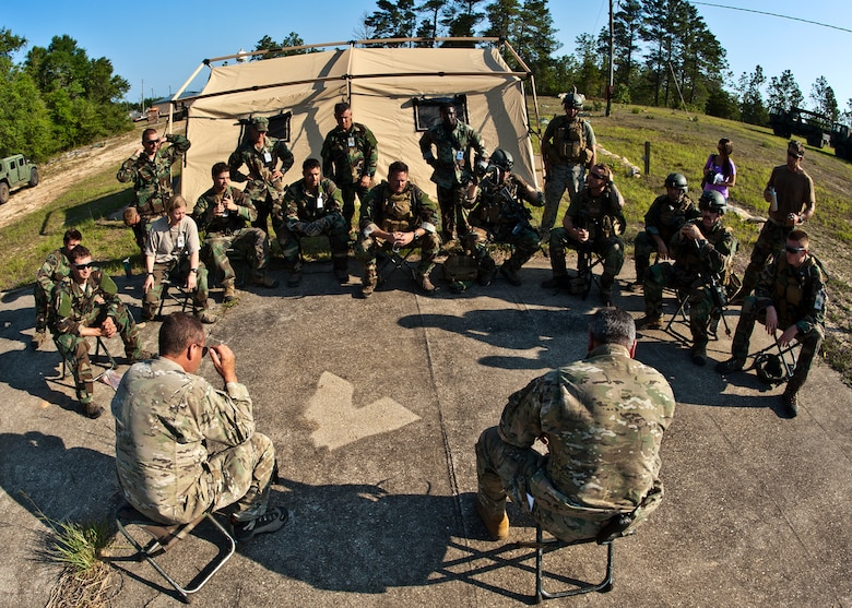 Combat Aviation Advisor students are debriefed by 371st Special Operations Training Squadron instructors after a scenario during the Raven Claw exercise May 24 at Duke Field, Fla.  As part of the exercise, 19 CAA students deploy to a foreign nation to advise and train their air forces in fixed wing and rotary aircraft operations.  The four-day exercise is the capstone of 12 weeks of baseline certification training for CAA.  The year-long process to become a CAA also includes months of language and flight training.  (U.S. Air Force photo/Tech. Sgt. Samuel King Jr.)
