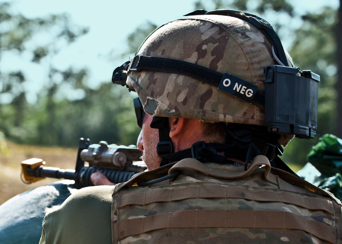 Tech. Sgt. Jason Parker scans downrange during the Combat Aviation Advisor course's Raven Claw exercise May 24 at Duke Field, Fla.  As part of the exercise, 19 CAA students deployed to a foreign nation to advise and train their air forces in fixed wing and rotary aircraft operations.  The four-day exercise is the capstone of 12 weeks of baseline certification training for CAA.  The year-long process to become a CAA also includes months of language and flight training.  (U.S. Air Force photo/Tech. Sgt. Samuel King Jr.)