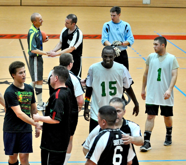 SPANGDAHLEM AIR BASE, Germany – Members from the 52nd Civil Engineer Squadron Force and 52nd Force Support Squadron Sabers shake hands after competing in the 52nd Fighter Wing's intramural indoor soccer championship game at the Skelton Memorial Fitness Center May 20. The Force defeated the Sabers 9-3 to win the championship.  (U.S. Air Force photo/Senior Airman Nick Wilson)