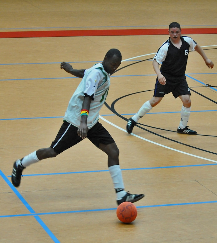 SPANGDAHLEM AIR BASE, Germany – Nana Opoku, 52nd Civil Engineer Squadron Force, prepares to shoot a goal as Ramon Munoznuno, 52nd Force Support Squadron Sabers, defends during the 52nd Fighter Wing's intramural indoor soccer championship game at the Skelton Memorial Fitness Center May 20. The Force defeated the Sabers 9-3 to win the championship. (U.S. Air Force photo/Senior Airman Nick Wilson)