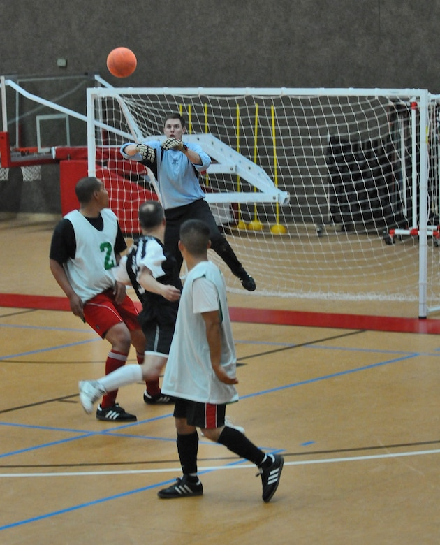 SPANGDAHLEM AIR BASE, Germany – Sean Conaway, 52nd Civil Engineer Squadron Force goalkeeper, blocks the ball during the 52nd Fighter Wing's intramural indoor soccer championship game against the 52nd Force Support Squadron Sabers at the Skelton Memorial Fitness Center May 20. The Force defeated the Sabers 9-3 to win the championship.  (U.S. Air Force photo/Senior Airman Nick Wilson)