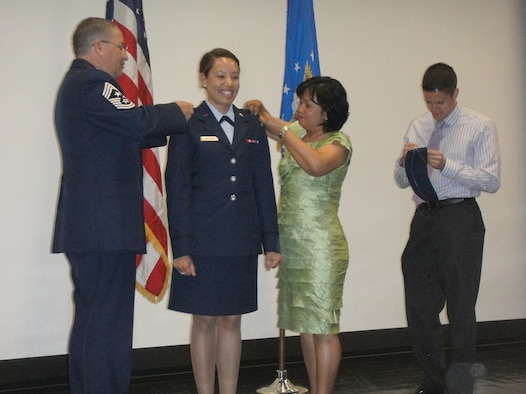 65th Air Base Wing Command Chief Samuel Hagadorn and his wife, Loida, pin second lieutenant bars on daughter Shannon Hagadorn at an AFROTC commissioning ceremony May 14 at the University of Arizona in Tucson.  (Courtesy photo)