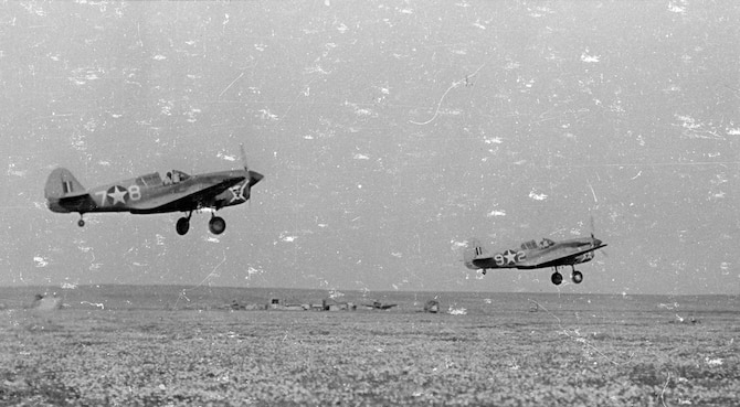 P-40s of the 66th Fighter Squadron take off on a mission over North Africa. (U.S. Air Force photo)