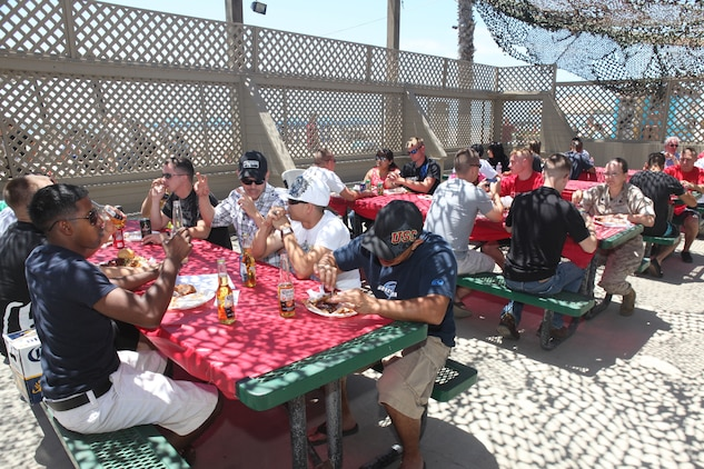 Marines and sailors from the 15th Marine Expeditionary Unit (MEU) enjoyed a pre-holiday barbeque at Camp Pendleton's Del Mar Beach, May 26. The event was held to help build camaraderie and a sense of family within the unit.
