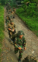 Marines and Sailors from Landing Force Company and Indonesian Mar