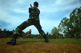 An Indonesian Marine from 6th Battalion, 2nd Brigade, Korps Marinir, demonstrates martial arts movements to U.S. Marines and Sailors with Landing Force Company during martial arts training May 27. Landing Force Company, comprised primarily of Marines from 2nd Battalion, 23rd Marine Regiment and 4th Assault Amphibian Battalion, 4th Marine Division, is participating in Cooperation Afloat Readiness and Training (CARAT) 2011. CARAT is an annual series of bilateral exercises held between the U.S. and Southeast Asian nations with the goals of enhancing regional cooperation, promoting mutual trust and understanding, and increasing operational readiness.  While in Indonesia, the service members from both nations will train together on martial arts, military operations on urban terrain, jungle warfare, combat marksmanship and combat lifesaving. (U.S. Marine Corps Photo by Cpl. Aaron Hostutler)