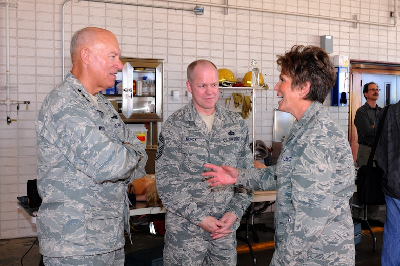 Retired Col. Karen Bence, former 162nd Mission Support Group commander, right, shows Lt. Gen. Harry M. Wyatt, Air National Guard director, and Air National Guard Command Chief Master Sgt. Christopher Muncy the base fighter station during a visit last year. Colonel Bence retired after 35 years of service this June. (U.S. Air Force photo/Maj. Gabe Johnson)
