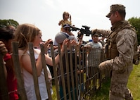 EAST MEADOW, N.Y. - A Marine teaches a child about a rifle after a helicopter raid demonstration at Eisenhower Park May 28. The demonstration was held by Marines with the 24th Marine Expeditionary Unit as part of Fleet Week New York 2011. More than 3,000 Marines, sailors and Coast Guardsmen are participating in community events and demonstrations as part of Fleet Week. This is the 27th year New York has hosted the sea services for Fleet Week. (Official Marine Corps photo by Sgt. Randall A. Clinton / RELEASED)
