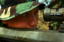 An Indonesian Marine looks through the scope of an M-82 Special Application Scoped Rifle during sniper training with U.S. Marines of Landing Force Company May 29. During the sniper training, U.S. and Indonesian Marines learned to operate one another's weapon systems. Landing Force Company is participating in Cooperation Afloat Readiness and Training (CARAT) 2011. CARAT is an annual series of bilateral exercises held between the U.S. and Southeast Asian nations with the goals of enhancing regional cooperation, promoting mutual trust and understanding, and increasing operational readiness. While in Indonesia, the service members from both nations train together on martial arts, military operations on urban terrain, jungle warfare, combat marksmanship and combat lifesaving.