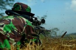 An Indonesian Marine fires an M-82 Special Application Scoped Rifle during sniper training with U.S. Marines of Landing Force Company May 29. During the sniper training, U.S. and Indonesian Marines learned to operate the weapon systems of one another. Landing Force Company is participating in Cooperation Afloat Readiness and Training (CARAT) 2011. CARAT is an annual series of bilateral exercises held between the U.S. and Southeast Asian nations with the goals of enhancing regional cooperation, promoting mutual trust and understanding, and increasing operational readiness. While in Indonesia, the service members from both nations train together on martial arts, military operations on urban terrain, jungle warfare, combat marksmanship and combat lifesaving.