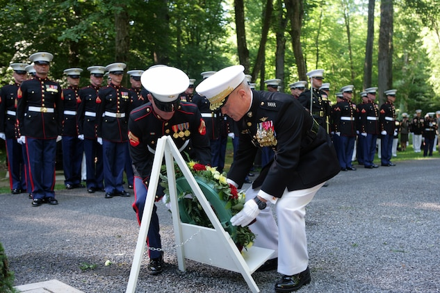The 35th Commandant of the Marine Corps General James F. Amos lays a wreath in front of the Iron Mike monument atop a hill in the heart of the Belleau Wood forest during a private Memorial Day ceremony in front of a formation of Marines and French soldiers. The Iron Mike monument was sculpted by Felix Weihs de Weldon, the artist who later designed the Marine Corps War Memorial in Washington, D.C., and was erected in honor of the 5th and 6th Marine Regiments after World War I. (Marine Corps photo by Master Sgt. Grady T. Fontana)