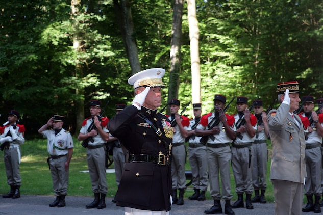 "The 35th Commandant of the Marine Corps General James F. Amos and French Commander of Land Forces Lt. Gen. Herve Charpentier salute the Iron Mike monument atop a hill in the heart of the Belleau Wood forest during a private Memorial Day ceremony in front of a formation of Marines and French soldiers. Following World War I, the French government renamed the Belleau Wood forest ""Wood of the Marine Brigade."" (Marine Corps photo by Master Sgt. Grady T. Fontana)"