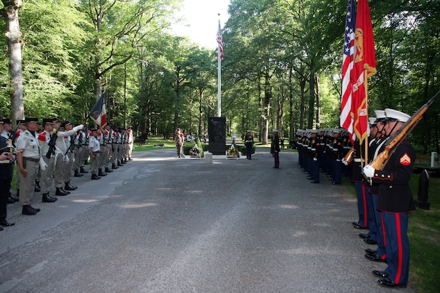 Two formations of Marines and French soldiers pay tribute to fallen U.S. service members atop a hill at the heart of the Belleau Wood forest during a private ceremony that was held prior the official Memorial Day ceremony, which was held in the Aisne-Marne American Cemetery here at the foot of the forest.(Marine Corps photo by Master Sgt. Grady T. Fontana)
