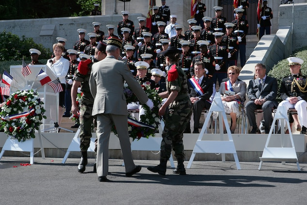 French Commander of Land Forces Lt. Gen. Herve Charpentier lays a wreath during a Memorial Day ceremony here at the foot of the steps that lead to the chapel at the Aisne-Marne American Cemetery in front of dignitaries and a formation of Marines from 5th and 6th Marine Regiments. More than 2,000 French and American visitors attended the Memorial Day ceremony here. (Marine Corps photo by Master Sgt. Grady T. Fontana)