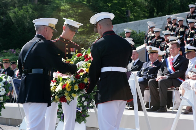 The 35th Commandant of the Marine Corps General James F. Amos lays a wreath at the foot of the steps that lead to the chapel at the Aisne-Marne American Cemetery in front of dignitaries and a formation of Marines from 5th and 6th Marine Regiments during a Memorial Day ceremony here. At the cemetery, there are 2,039 known buried and 250 unknown. In the chapel, there are 1,060 names inscribed on the walls to commemorate the missing—all from the Battle of Belleau Wood. (Marine Corps photo by Master Sgt. Grady T. Fontana)