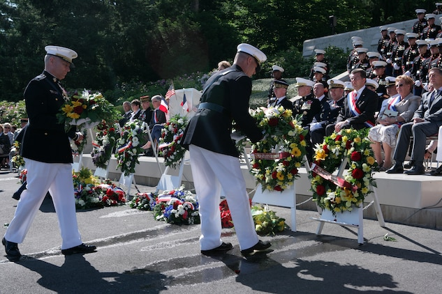 Lt. Gen. John M. Paxton Jr. (left), commanding general, II Marine Expeditionary Force and Brig. Gen. Paul W. Brier, deputy commander, Marine Corps Forces Europe, lay a wreath at the foot of the steps that lead to the chapel at the Aisne-Marne American Cemetery in front of dignitaries and a formation of Marines from 5th and 6th Marine Regiments during a Memorial Day ceremony here. At the cemetery, there are 2,039 known buried and 250 unknown. In the chapel, there are 1,060 names inscribed on the walls to commemorate the missing—all from the Battle of Belleau Wood. (Marine Corps photo by Master Sgt. Grady T. Fontana)