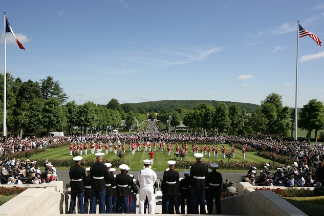"The ""Commandant's Own"" drum and bugle corps performed in front of a crowd of more than 2000 on the parade field of the Aisne-Marne American Cemetery during a Memorial Day ceremony in honor of the 93rd anniversary of the Battle of Belleau Wood. More than 1,800 Marines from the 5th and 6th Regiments lost their lives in the 21-day battle that stopped the last German offensive in 1918. (Marine Corps photo by Master Sgt. Grady T. Fontana)"